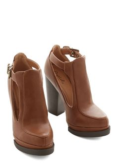 Tremendous Talent Bootie in Cognac. You have a real flair for rocking the raw power of these cognac-hued high-heeled booties! #brown #modcloth