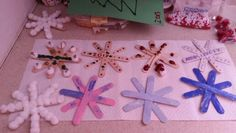 A great craft for winter-Painted snowflakes on Popsicle sticks  Use sparkles, stickers, and glitter to create beauty in your windows.