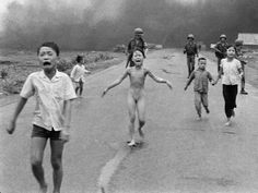 In this Pulitzer Prize-winning photo, 9-year-old Kim Phuc, center, runs down Route 1 near Trang Bang, Vietnam after an aerial napalm attack on June 9, 1972. The young girl ran naked along the road severely burned after she tore off her burning clothes during the South Vietnamese attack.