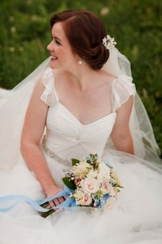 Gorgeous bride in white wedding gown with bouquet #flowers #weddinggown  Photo by: Jessica Jones Photography on Bridal Musings