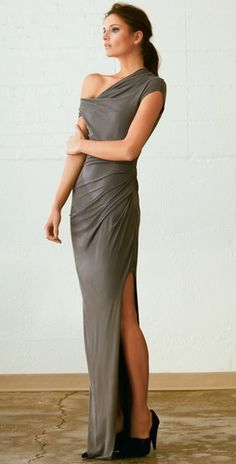 "Helmut Lang's Asymmetrical Long Dress:  This jersey maxi dress features asymmetrical draping and a cowl neck. Ruching and 35"" slit at side. Raw edges. 3"" strap at right shoulder. Ruched short sleeve at left. Lined.    * 64"" long, measured from shoulder.  * Fabrication: Soft jersey.  * Shell: 95% bemberg cupro/5% elastane.  * Lining: 100% polyester.  * Wash cold.  * Made in the USA."