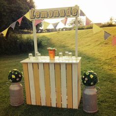 """This is a bespoke built lemonade stand. The stand comes in four pieces and once assembled is very sturdy. It also features a hand-painted """"Lemonade"""" sign."""