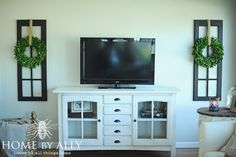 Love this! There's not enough depth for shelves, but something needs to go on the sides of the tv