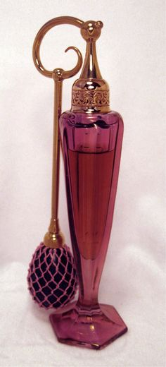 DeVilbiss Perfume Bottle Cranberry luster with Rams Head top. Circa 1926.