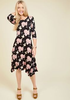 I Beg Your Garden Floral Dress. Forgive us for interrupting, but we think you'd look amazing in this black dress! #multi #modcloth