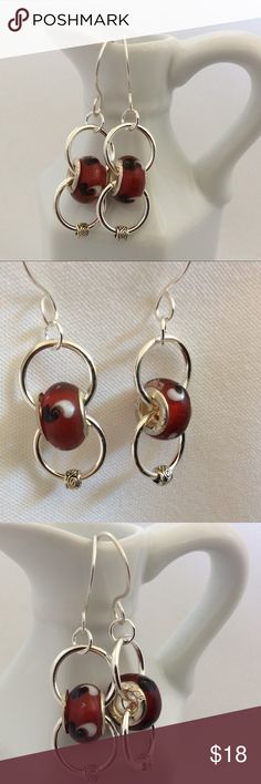 """Burgundy and Silver Drop Earrings I have made these beautiful earrings using two burgundy large-hole beads. Very unique and a great go to earring. Dress it up or down and it looks great. They are about 1.5"""" long. Becky Barnes Designs Jewelry Earrings"""
