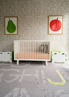 Simple nursery design with fruit wall art