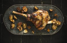 A festive dish with a whole leg of lamb, roasted with garlic