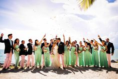 15 of Our Favorite Summer Weddings: Seafoam-green bridesmaid dresses and groomsmen in salmon-pink chinos - a fun and colorful summer color palette! {Limelight Photography}