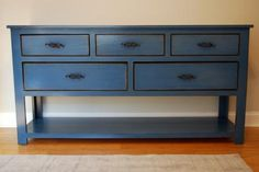 I was thinking of doing a pretty cherry colored TV stand in my living room... but I'm really LOVING the idea of a blue one... maybe even a little antic-ish!