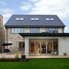 This fits well with the original house and the overhang is subtle. I like the fact that it's not entirely symmetrical too. Extension Veranda, Orangery Extension, House Extension Plans, House Extension Design, Roof Extension, House Design, Extension Google, Extension Ideas, Bungalow Extensions