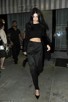 Kendall Jenner bares her toned midriff in quirky crop top as she heads to dinner with her stylish sisters during NYFW