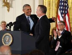 President Barack Obama greets actor Tom Hanks during a ceremony presenting Hanks with a Presidential... - AP Photo/Manuel Balce Ceneta