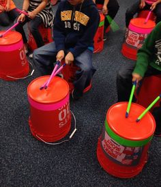 10 Home Depot buckets, neon tape, rhythm The kids sit on one bucket and play the other. The buckets create different sounds depending on where you hit them. It teaches kids to alternate/coordinate hands while reading and saying rhythms. Preschool Music, Music Activities, Drum Lessons, Music Lessons, Bucket Drumming, Middle School Music, Music Lesson Plans, Music And Movement, Piano Teaching