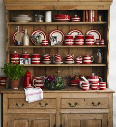 classic wooden pantry & cute red-striped pottery (by Cornishware)