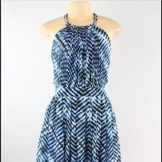 Blue Print Chain Racerback Dress New with tags! Gorgeous racerback dress by Calvin Klein. Chain neck detailing clasps at nape. Zips down back. Flared skirt. Blue, white and black pattern. Very flattering fit. Size 8. Not my size or I'd be keeping this - my loss, your gain   100% polyester shell and lining. Calvin Klein Dresses