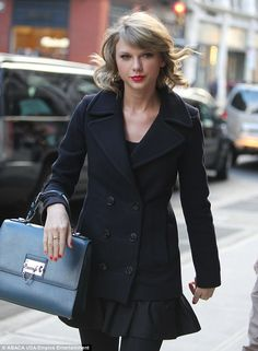 Taylor Swift Sticks to Colored Accessories for Her All-Black Getup   Buy ➜ http://shoespost.com/taylor-swift-isola-red-boots-blue-dolce-gabbana-bag/
