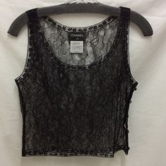 """Chanel Lace Cami Sz 38 Up for your consideration is a black lace camisole from Chanel. It is a size 38 which is a US size small. There are cute little signature """"CC"""" buttons down the side.  It is in excellent condition. CHANEL Tops Camisoles"""