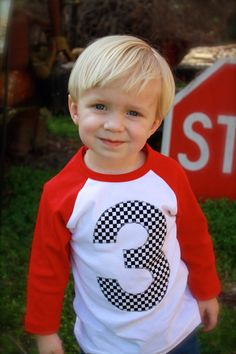 Little blondie w/ blue eyes.Race Car black white checker Flag Red and white with navy 3 baseball sports raglan boys birthday shirt with navy one kids birthday theme first party Hot Wheels Party, Festa Hot Wheels, Hot Wheels Birthday, Race Car Birthday, Race Car Party, Disney Cars Birthday, Monster Truck Birthday, Birthday Boy Shirts, 3rd Birthday
