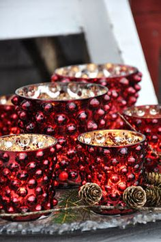 Red mercury glass votives -- so festive from Lily and Tulip (Swedish) votives are from her on-line store ---