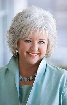 Gray short hairstyles with bangs for older women with round faces and thick hair
