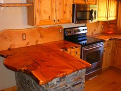 A cabin ora rustic designed houseis not complete without a rustic kitchen countertop. If you're (re)designing your home or kitchen for therustic look, don't forget these wonderful inspiration! The kitchen is one of the busiest and most used areas in any house. But many homeowners don't give much thought to designing it as much as they do bedrooms or living areas.The owners of these kitchen countertops, however, must really love rustic design and spending time in the kitchen! T...