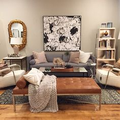 Alice Lane Home Collection   Cognac leather bench and bunny art