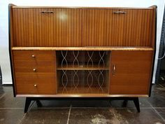 Mid-century modern cocktail cabinet and desk by Lebus of London.