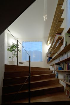 upon entering the dwelling, a continuous spatial experience is immediately unveiled with rooms integrated into a stairway which curves around structural columns from the entry to the second floor.