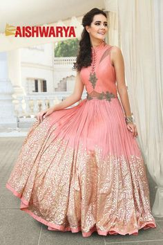Sparkle on your special day in this charming designer gown. Buy Gown online - http://www.aishwaryadesignstudio.com/modish-peach-designer-gown-with-foil