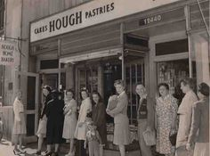 Customers form a line outside of a Hough Bakery in 1945.