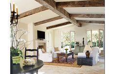 Recycled timber and a low-pitched plaster ceiling lends to the country charm found in this living room.