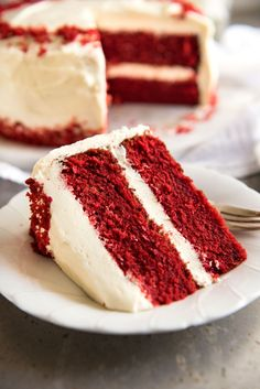 This is the BEST Red Velvet Cake recipe, and with my tips, it is so easy to make. Bright red, perfect, velvety sponge with fluffy cream cheese frosting.