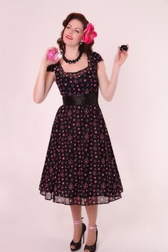 Jenny | Bettie Page Clothing -- this dress is cute and has a sassy back
