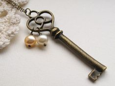 Items similar to secret treasures necklace, victorian key charm necklace, dangle cream ivory peach pearl pendant, antique brass, cute jewelry gift idea on Etsy Key Jewelry, Cute Jewelry, Jewelry Crafts, Beaded Jewelry, Jewelery, Handmade Jewelry, Jewelry Making, Unique Jewelry, Jewelry Accessories