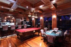 Remarkable stained wood covers the floors, walls, and ceiling in this gorgeous finished basement. A full bar and other gaming units are featured for entertainment.  Source: http://www.zillow.com/digs/Home-Stratosphere-boards/Random-Rooms-I-Like/