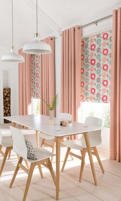 White and natural wood shades create the perfect Scandi theme, pair this with bright pops of colour such as pink in soft furnishings such as Horizon Salmon made to measure Curtains and Freyja Coral Roman blinds add a lovely finishing touch.
