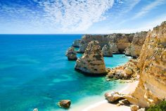 The 19 Best Places to Visit in Portugal | Praia da Marinha in Portugal's Algarve