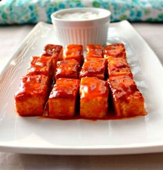 Tofu Buffalo Bites!!    Tofu: Extra Firm Tofu-1 (15 Oz pack)  Salt-1/4 tsp  Pepper-1/2 tsp  Extra Virgin Olive Oil-2 tbsp    Sauce: Franks Buffalo Wing Sauce-1/4 cup  Canola Oil-2 tbsp  Honey-3 tbsp     Recipe here: http://www.sonisfood.com/2013/02/tofu-buffalo-bites-for-superbowl-sundaysupper.html#