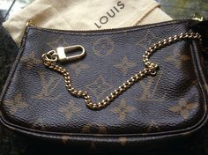 Louis Vuitton Pouchette Mini Monogram Wristlet $275