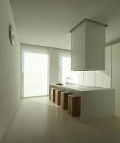 Kitchen island with stools inside the House in Ontiyet by Sergio Garcia-Gasco.