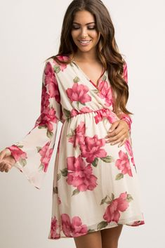 A floral, chiffon maternity dress featuring a wrap v-neckline, semi-sheer long bell sleeves, and a cinched elastic waistline. Body is double lined to prevent sheerness. This style was created to be worn before, during, and after pregnancy.