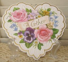 """Carol Wilson Mother's Day Embossed Greeting Card Die Cut Heart by Carol Wilson Fine Arts, Inc.. $3.95. © Carol Wilson Fine Arts, Inc.. 5 1/4"""" x 5 1/4"""" Embossed Card With Envelope. Cover: """"Mother"""" Lace Like Embossed Die Cut Heart. Made In The USA. Inside Message:  Happy Mother's Day With Love.  You Are Always In My Heart. Beautifully Embossed Die Cut Greeting Card With Envelope."""