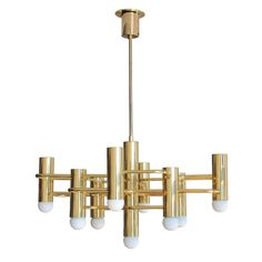 Boulanger Brass Chandelier   From a unique collection of antique and modern chandeliers and pendants  at https://www.1stdibs.com/furniture/lighting/chandeliers-pendant-lights/