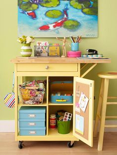 Craft Supply Storage Cart- This rolling cart turned art desk also provides a durable work surface on top and storage in cubbies below. Add labeled boxes and bins for supplies. Throw swatches into a wire bin, and hang a tote of supplies from the hook on the side for easy access. The drop side panel is perfect for extra work space.