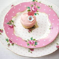 """New for 2013!!!  """"New Country Roses Cheeky Pink""""  """"Cheeky Pink features classically rendered roses with a fashion forward splash of beguiling pink. The Plate is awash in fresh pink and white dots with signature pink rims on scalloped bone china and luxurious gold banding"""""""