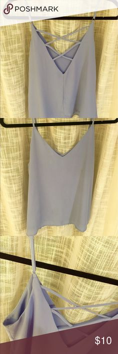 Light Purple Tank Top Light purple spaghetti strap tank from Forever 21. Size M. Adjustable straps, double lined, 100% polyester, hand was only. Fun criss cross back, v neck and flowy Forever 21 Tops Tank Tops