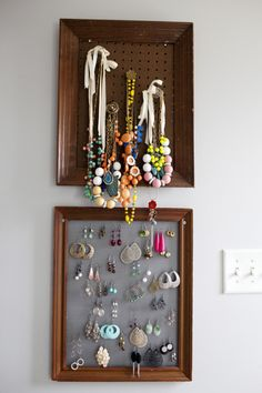 via Design Sponge - two organizers using old frames, window screening and peg board to keep it all within easy reach.
