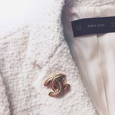 Vintage Chanel brooch and new Zara boucle jacket