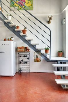 Staircase Space Idea Creative Ways To Use The Space. One of my favorite features of their home is a grand staircase right past the front door that has some awkward storage space underneath. Steel Stairs, Loft Stairs, House Stairs, Staircase Handrail, Modern Staircase, Staircase Design, Grand Staircase, Staircases, Vintage Apartment